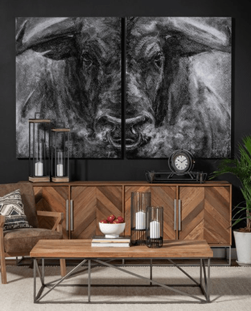 Black and grey animal oil painting in a living room interior design setting with chevron style credenza and coffee table by by Mercana