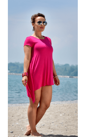 Pink bamboo asymmetrical top by Rapz women apparel, casual wear, worn by a woman wearing sunglasses by the beach