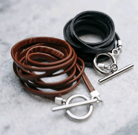 Two leather chokers in black and brown with silver clasps by Canadian handmade jewelry artist Atelier Syp