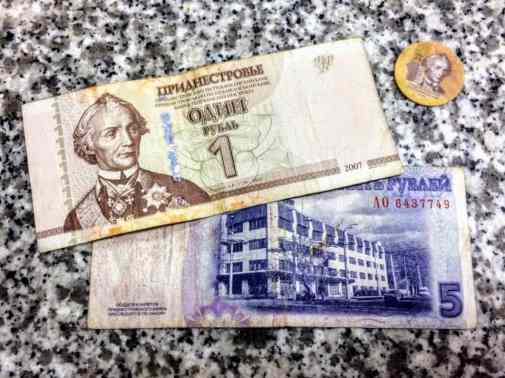 some Transnistrian Ruble bills, and a plastic coin