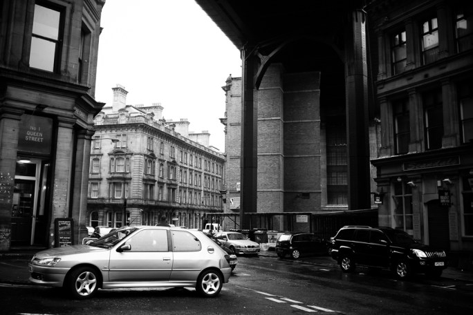 Underneath the Tyne bridge cars zip left and right carrying people busily on their way, oblivious to the over one thousand year history of the city.