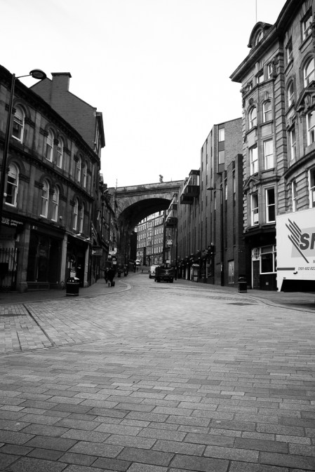 Newly laid road surfaces replace worn cobblestones on one of the steep streets leading out of the quayside.