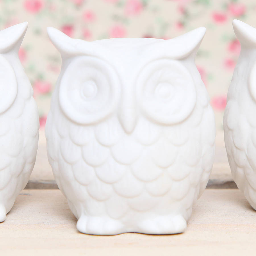 ceramic owl decoration by red berry apple