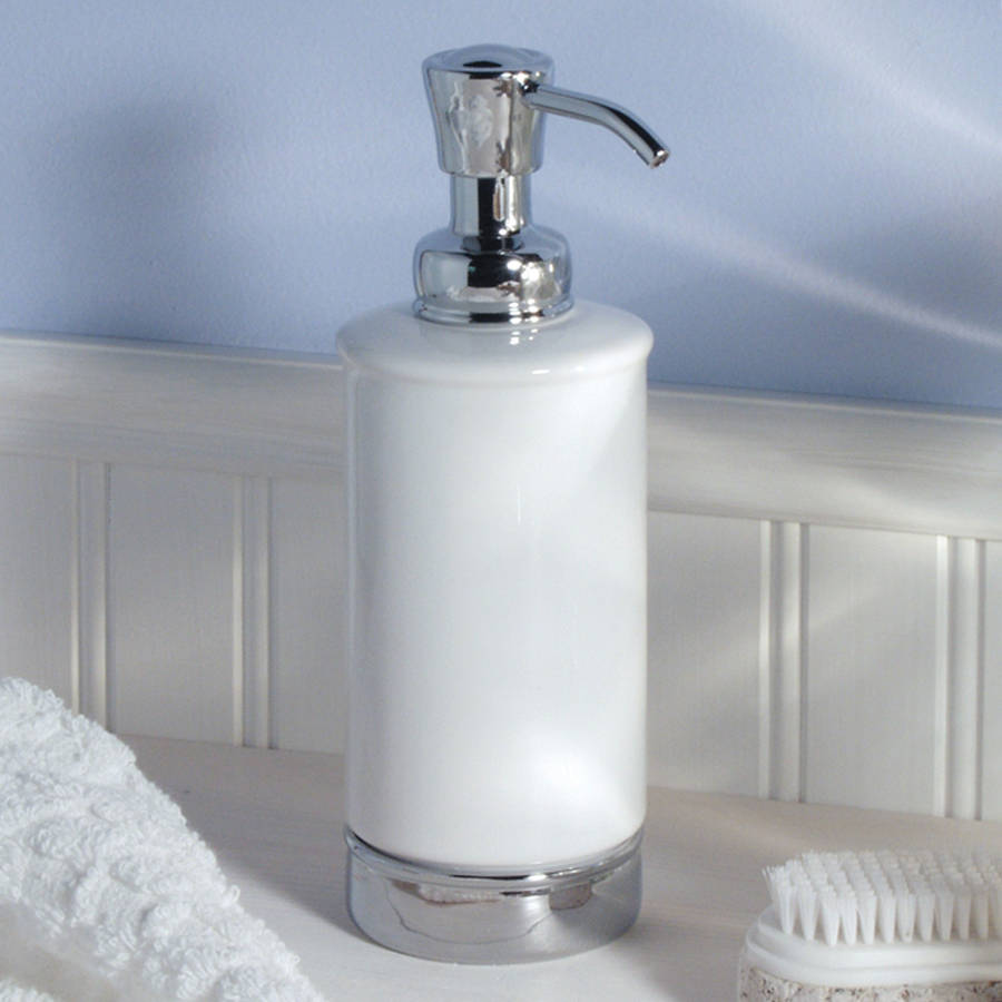 white soap dispenser and matching bathroom accessories by