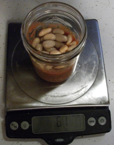 Add 1/4 beans to each jar