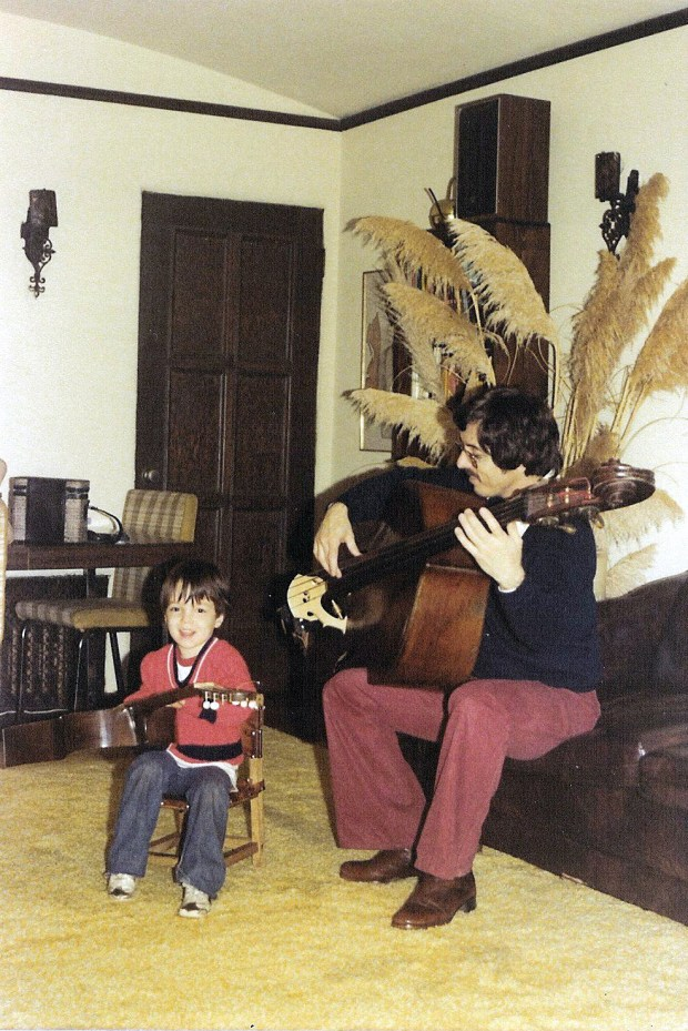 Damian and his dad play instruments