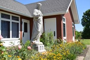 Sacred Heart Statue in garden