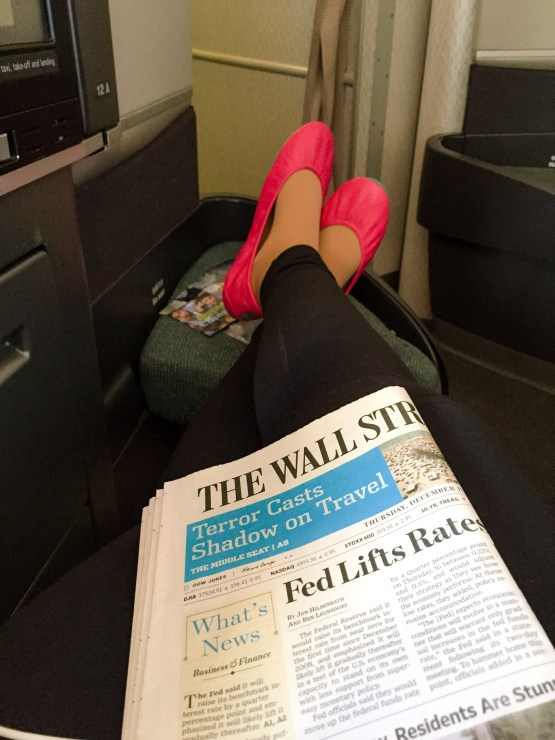 Note the headline on The Wall Street Journal...what shadow? From my stretched legs on Cathay Pacific?