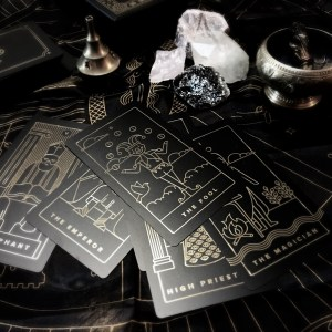 golden tread tarot deck surrounded by crystals and incense