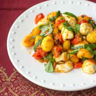 Pan-fried gnocchi with oven-roasted tomatoes, mozzarella, and loads of fresh basil. A cozy date-night meal!
