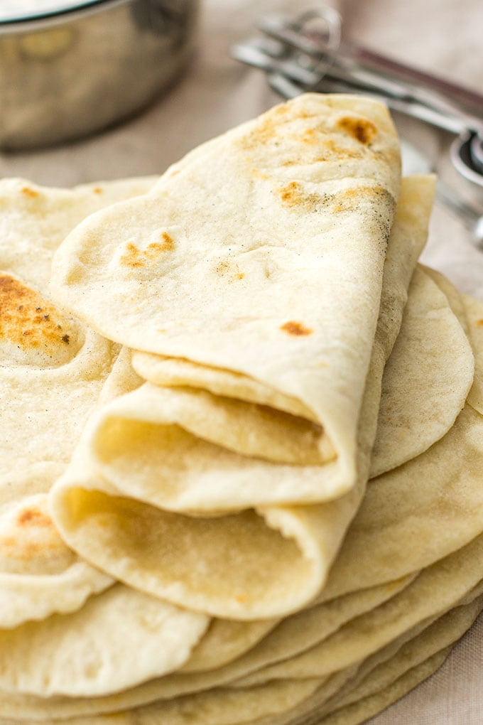 Easy flour tortillas from scratch | Take tacos, enchiladas, burritos, and more to the next level with easy, homemade flour tortillas, made from scratch with just 5 simple ingredients.