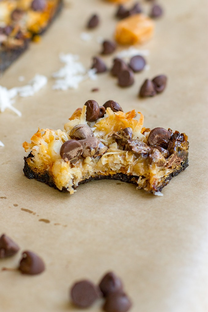 Shortcut Samoa cookie bars | Chocolate chips, caramel sauce, coconut, and an Oreo crust make an easy at-home version of the classic Girl Scout cookie.