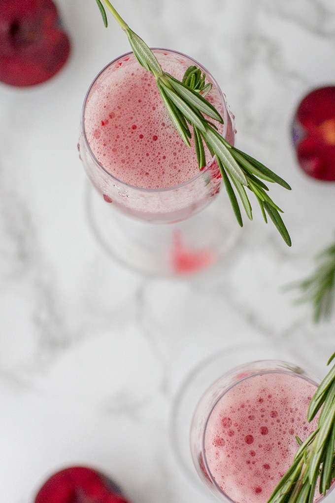 Rosemary plum bellini | A festive, fruit spin on the classic sparkling cocktail with champagne or prosecco. A perfect late summer or holiday drink!