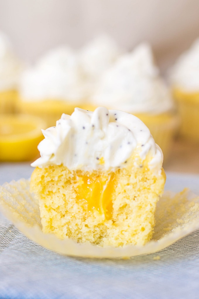 Perfect filled lemon cupcakes, with lemon curd in the center and topped with cream cheese poppyseed frosting. #springdesserts #lemondesserts #cupcakes #lemon