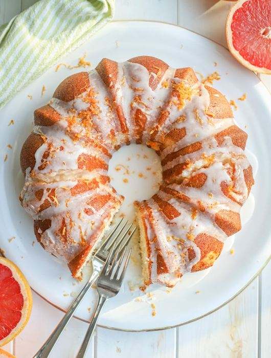Flat-lay photo of glazed grapefruit bundt cake.