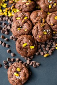 A pile of sea salt pistachio chocolate chip cookies.
