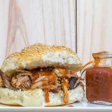 Recipe for the perfect pulled pork, including brine, rub and barbecue sauce. Tips and instructions included to make your first attempt a success.