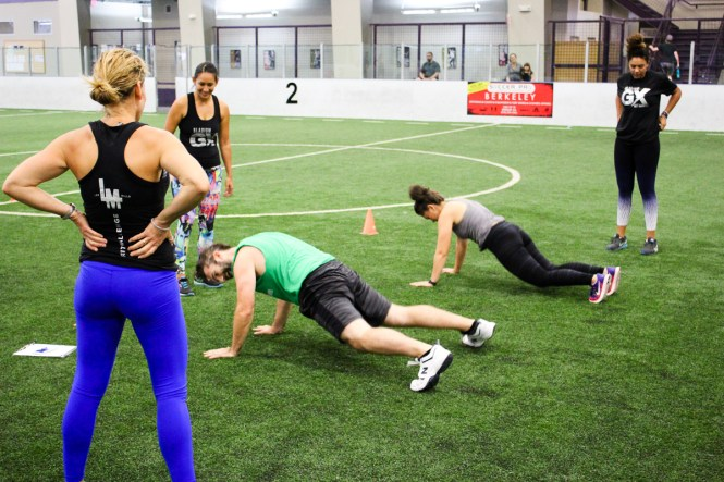 Performing burpees at the Bladium GRIT Competition at Bladium Fitness Alameda