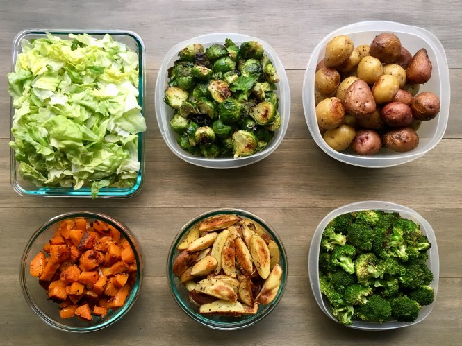 Whole30 meal prep foods: lettuce, roasted brussels sprouts, roasted potatoes, roasted butternut squash, broccoli