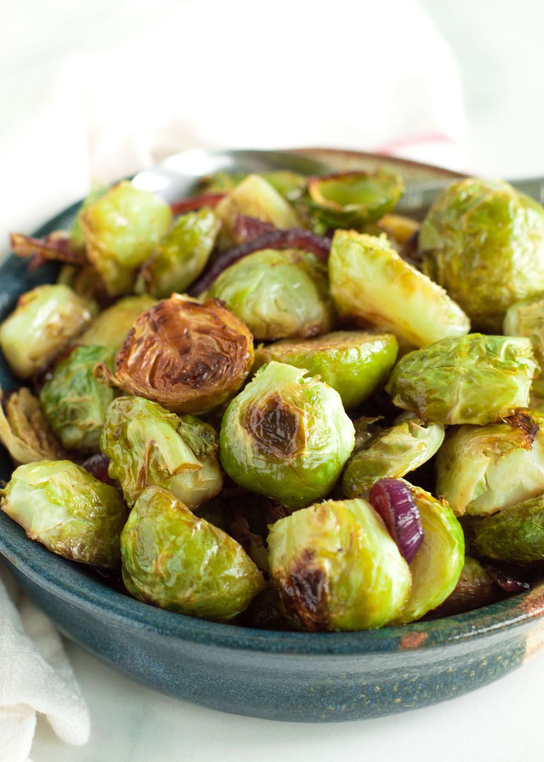 Perfectly tender and caramelized Honey Balsamic Brussels Sprouts are a tasty side dish for any warm and cozy fall dinner. This Brussels sprout recipe is easy to make, gluten free, dairy free, vegan possible and so very delicious.