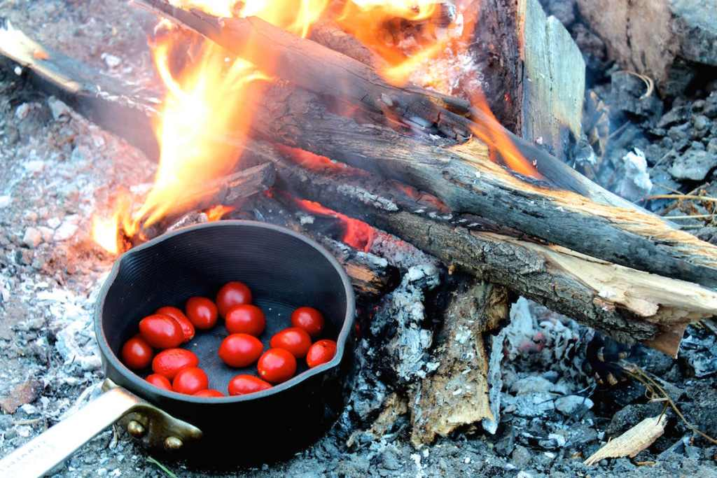 Roasting tomatoes for Campfire Chicken Paella | Nourishing Wild