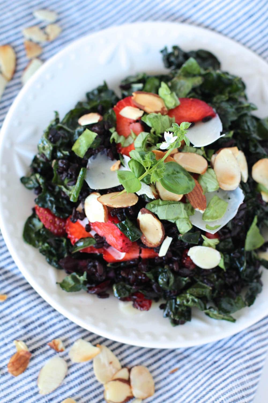 Wild Kale Salad Recipe - kale salad with strawberries, toasted almonds, parmesan cheese, basil   Nourishing Wild