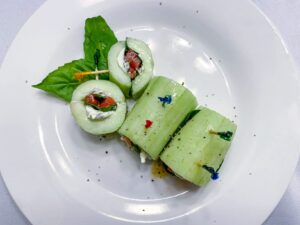 Cucumber sandwiches sliced on a white plate