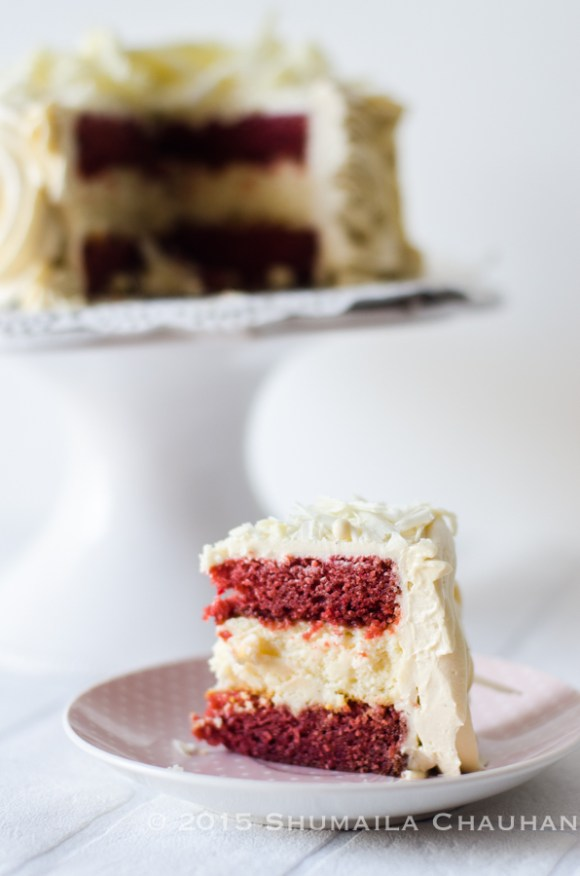 New York Cheesecake between two layers of red velvet cake