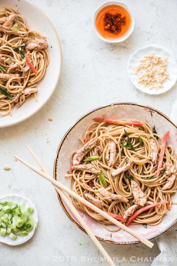 This asian flavored chicken noodle salad with poached chicken, a spicy sesame oil dressing and noodles will become a favorite of yours.