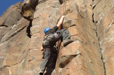 A student from our therapeutic boarding school rock climbs.