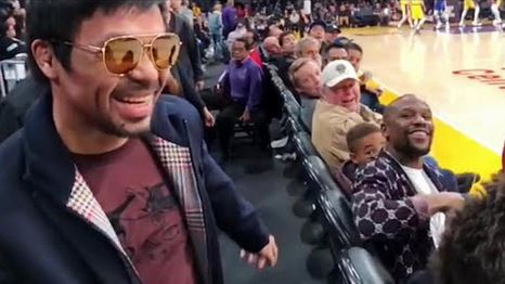 Photo: Floyd Mayweather and Manny Pacquiao greet each other at Lakers vs Warriors game