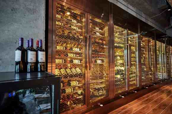 THE SECOND-FLOOR BALCONY BOASTS A STUNNING WINE SELECTION