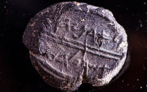 A small 7th century BCE clay sealing reading 'Belonging to Adoniyahu, Royal Steward,' recently discovered in the City of David's sifting project, taken from earth excavated under Robinson's Arch.