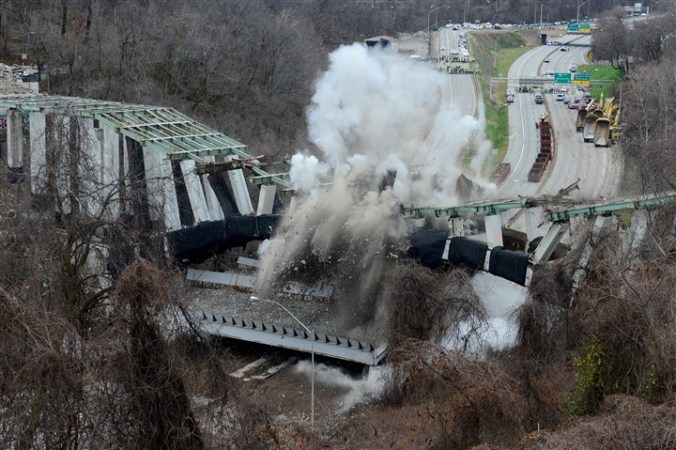 Bridge collapses after detonation of charges (click here for video)