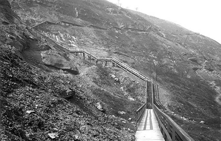 This is why we went to a lot of trouble to ride through or over Mount Washington. Many workers walked this every day. It is a 1910 view of Indian Trail Steps, named after a path that followed the same route. Believe it or not, people took horses and wagons on the trail before these steps stopped them.