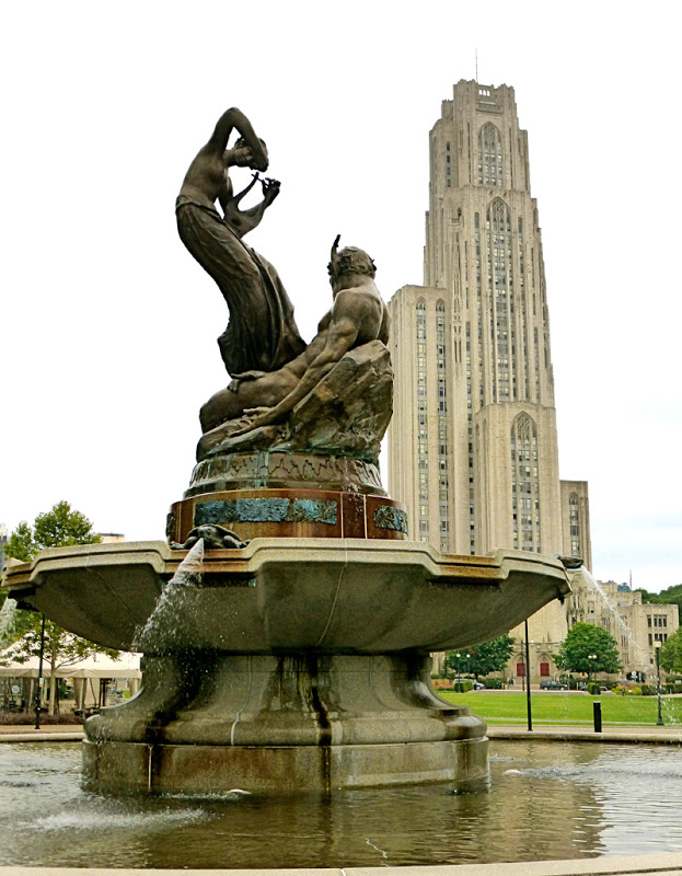 "This fountain at the entrance to Schenley Park was erected to Mary's memory in 1918. The female figure represents ""sweet humanity"" taming Pan, the Greek God of Nature, with music. That's what parks of that time were to be about. The fountain designer, Victor David Brenner, is responsible for the artwork you keep on your dresser. He designed the Lincoln penny."