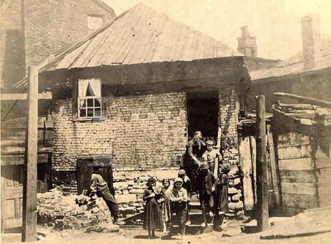 The American Dream, a house with gun ports. These are tenants living in the Fort Pitt Block House in the 1890s.