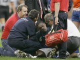 ** FILE ** Serge Betsen of France receives treatment after taking a knock during the Rugby World Cup quarterfinal match between France and New Zealand at the Millennium Stadium in Cardiff, Wales, in this Saturday Oct. 6, 2007 file photo. Betsen, who has recovered from a mild concussion sustained last weekend. Betsen has been included in the lineup for Saturday's semifinal against England even though the rules state that a player who has been concussed should be automatically left out for three weeks. (AP Photo/Christophe Ena)