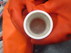 Researcher Russ Hopcroft holds a cup of filtered Glacier Bay seawater with masses of zooplankton visible.