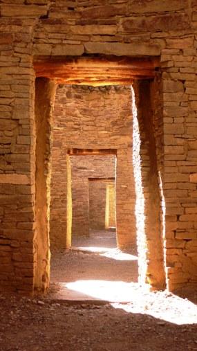 Photo looking through a series of doorways at Pueblo Bonito