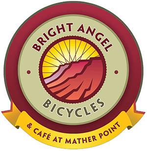 Parlak Melek Bisiklet Logosu, bisiklet tekerleği parmaklıklarından oluşan bir daire içinde kanyon kayalıklarının silüetlerini gösterir.