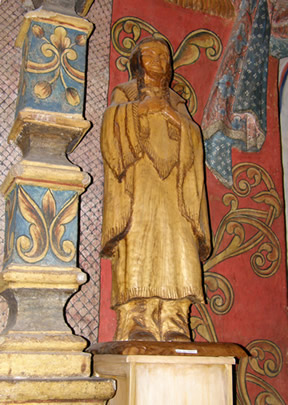 This wooden statue of an O'odham woman is part of the interior wall design in San Xavier del Bac.
