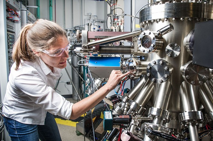 A researcher works with scientific equipment in a lab