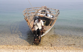 Photo of a boat on the shoreline of Lake Tanganyika.