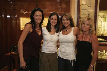 Leigh Teixeira is the 2nd one from the left, with the dark hair, brown pants and white shirt, I think.