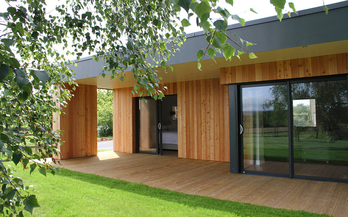 hight resolution of requirements biomass fuelled underfloor heating throughout a single storey luxury lodge with large areas of glazing with seamless transition between floor