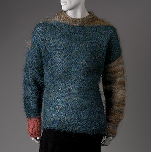Vivienne Westwood Loosely knit mohair with color blocks of blue green, rust, and gray - photo courtesy of Met Museum online