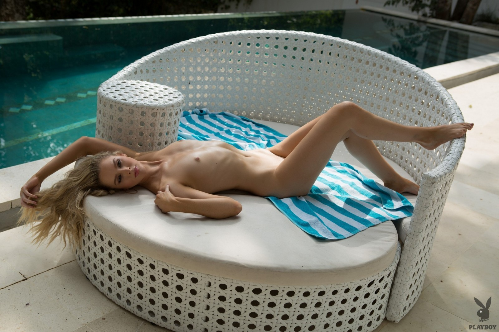 Blonde bombshell Thera Jane gets naked at the pool