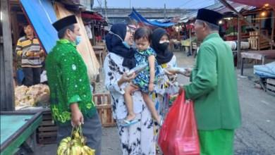 Photo of Giat Hardiknas Pergunu Depok Bagikan Ratusan Takjil Nasi Kotak ke Warga Kolong Plyover