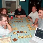 Gamers gathered around a table playing a fantasy card game.